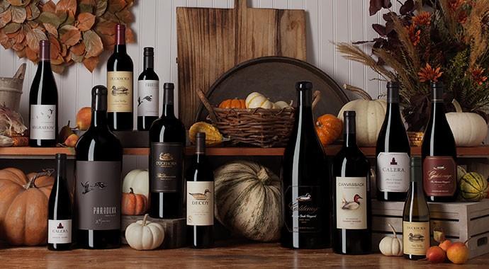 Twelve wine bottle of Duckhorn Portfolio on a harvest table