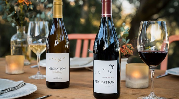 Migration Chardonnay and Pinot Noir on an outdoor table