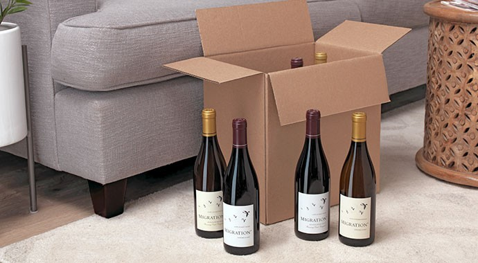 Migration Pinot Noir and Chardonnay wines in a living room