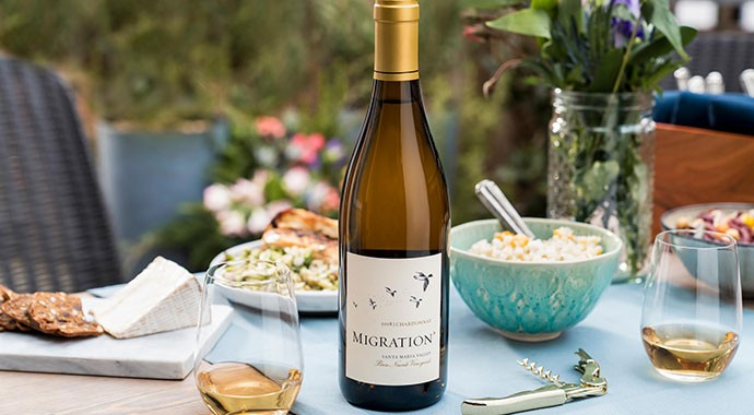 Migration Chardonnay on an outdoor table