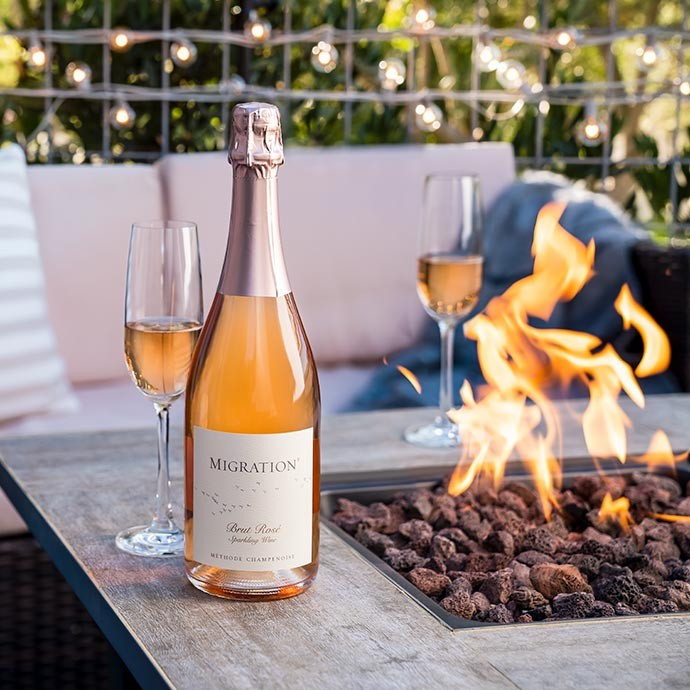 Migration Sparkling Wine next to the fire
